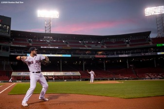 BOSTON, MA - AUGUST 31: Michael Chavis #23 of the Boston Red Sox warms up as the suns sets before a game against the Atlanta Braves on August 31, 2020 at Fenway Park in Boston, Massachusetts. The 2020 season had been postponed since March due to the COVID-19 pandemic. (Photo by Billie Weiss/Boston Red Sox/Getty Images) *** Local Caption *** Michael Chavis