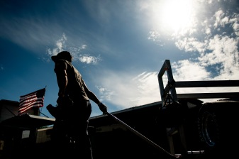 A crew member pulls equipment during the Thompson 150 for the NASCAR Whelen Modified Tour at Thompson Speedway Motorsports Park in Thompson, Connecticut on September 3, 2020. (Billie Weiss/NASCAR)