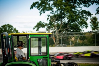 A worker looks on as the practice round is held during the Thompson 150 for the NASCAR Whelen Modified Tour at Thompson Speedway Motorsports Park in Thompson, Connecticut on September 3, 2020. (Billie Weiss/NASCAR)