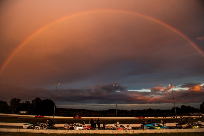 A rainbow forms during qualifying during the Thompson 150 for the NASCAR Whelen Modified Tour at Thompson Speedway Motorsports Park in Thompson, Connecticut on September 3, 2020. (Billie Weiss/NASCAR)
