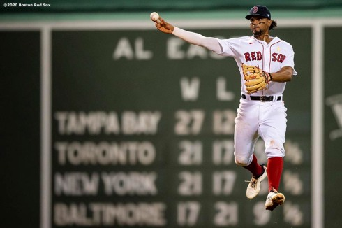 BOSTON, MA - SEPTEMBER 5: Xander Bogaerts #2 of the Boston Red Sox jumps as he throws during the eighth inning of a game against the Toronto Blue Jays on September 5, 2020 at Fenway Park in Boston, Massachusetts. The 2020 season had been postponed since March due to the COVID-19 pandemic. (Photo by Billie Weiss/Boston Red Sox/Getty Images) *** Local Caption *** Xander Bogaerts