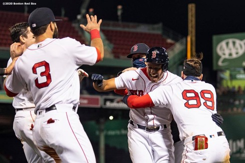 BOSTON, MA - SEPTEMBER 5: Yairo Munoz #60 of the Boston Red Sox celebrates with teammates after hitting a game winning walk-off RBI single during the ninth inning of a game against the Toronto Blue Jays on September 5, 2020 at Fenway Park in Boston, Massachusetts. The 2020 season had been postponed since March due to the COVID-19 pandemic. (Photo by Billie Weiss/Boston Red Sox/Getty Images) *** Local Caption *** Yairo Munoz