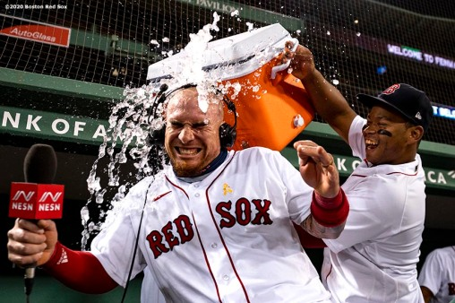 BOSTON, MA - SEPTEMBER 5: Christian Vazquez #7 of the Boston Red Sox is doused with Gatorade after scoring the game winning run on a walk-off infield single by Yairo Munoz #60 of the Boston Red Sox during the ninth inning of a game against the Toronto Blue Jays on September 5, 2020 at Fenway Park in Boston, Massachusetts. The 2020 season had been postponed since March due to the COVID-19 pandemic. (Photo by Billie Weiss/Boston Red Sox/Getty Images) *** Local Caption *** Christian Vazquez