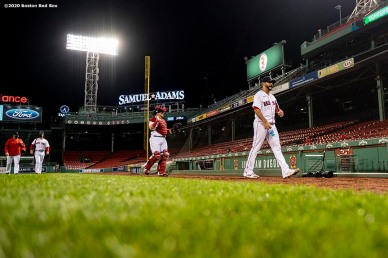 BOSTON, MA - SEPTEMBER 18: Martin Perez #54 and Christian Vazquez #7 of the Boston Red Sox walk toward the dugout before a game against the New York Yankees on September 18, 2020 at Fenway Park in Boston, Massachusetts. The 2020 season had been postponed since March due to the COVID-19 pandemic. (Photo by Billie Weiss/Boston Red Sox/Getty Images) *** Local Caption *** Martin Perez; Christian Vazquez