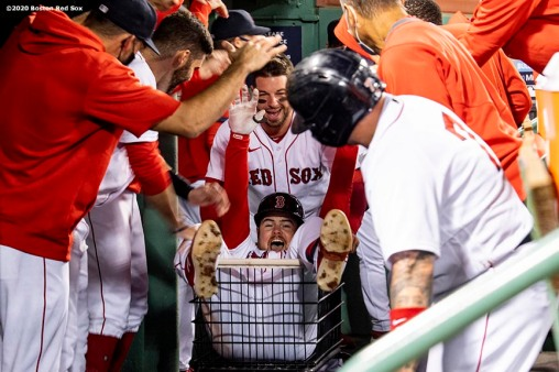 BOSTON, MA - SEPTEMBER 18: Christian Arroyo #39 of the Boston Red Sox reacts as he is pushed in a cart by Kevin Plawecki #25 after hitting a go ahead three run home run during the fourth inning of a game against the New York Yankees on September 18, 2020 at Fenway Park in Boston, Massachusetts. The 2020 season had been postponed since March due to the COVID-19 pandemic. (Photo by Billie Weiss/Boston Red Sox/Getty Images) *** Local Caption *** Christian Arroyo; Kevin Plawecki