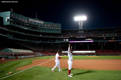 BOSTON, MA - SEPTEMBER 19: Rafael Devers #11 and Xander Bogaerts #2 of the Boston Red Sox warm up before a game against the New York Yankees on September 19, 2020 at Fenway Park in Boston, Massachusetts. The 2020 season had been postponed since March due to the COVID-19 pandemic. (Photo by Billie Weiss/Boston Red Sox/Getty Images) *** Local Caption *** Xander Bogaerts; Rafael Devers