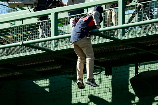 BOSTON, MA - SEPTEMBER 20: A fan who broke into the stadium interferes with the game as he climbs on the center field camera platform during the eighth inning of a game between the Boston Red Sox and the New York Yankees on September 20, 2020 at Fenway Park in Boston, Massachusetts. The 2020 season had been postponed since March due to the COVID-19 pandemic. (Photo by Billie Weiss/Boston Red Sox/Getty Images) *** Local Caption ***
