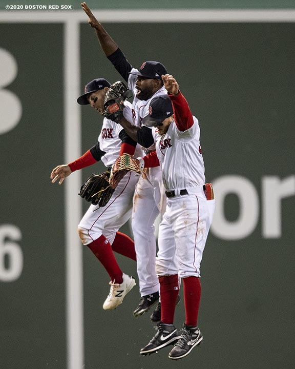 BOSTON, MA - SEPTEMBER 22: Michael Chavis #23, Jackie Bradley Jr. #19, and Alex Verdugo #99 of the Boston Red Sox celebrate a victory against the Baltimore Orioles on September 22, 2020 at Fenway Park in Boston, Massachusetts. The 2020 season had been postponed since March due to the COVID-19 pandemic. (Photo by Billie Weiss/Boston Red Sox/Getty Images) *** Local Caption *** Michael Chavis; Jackie Bradley Jr.; Alex Verdugo