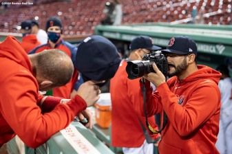 BOSTON, MA - SEPTEMBER 23: Martin Perez #54 takes a photo of Christian Vazquez #7 of the Boston Red Sox before a game against the Baltimore Orioles on September 23, 2020 at Fenway Park in Boston, Massachusetts. The 2020 season had been postponed since March due to the COVID-19 pandemic. (Photo by Billie Weiss/Boston Red Sox/Getty Images) *** Local Caption *** Martin Perez