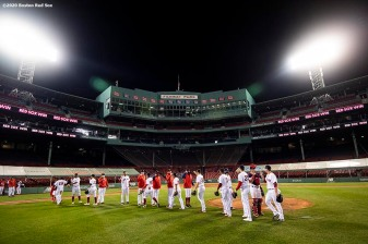 BOSTON, MA - SEPTEMBER 23: Members of the Boston Red Sox celebrate a victory against the Baltimore Orioles on September 23, 2020 at Fenway Park in Boston, Massachusetts. The 2020 season had been postponed since March due to the COVID-19 pandemic. (Photo by Billie Weiss/Boston Red Sox/Getty Images) *** Local Caption ***